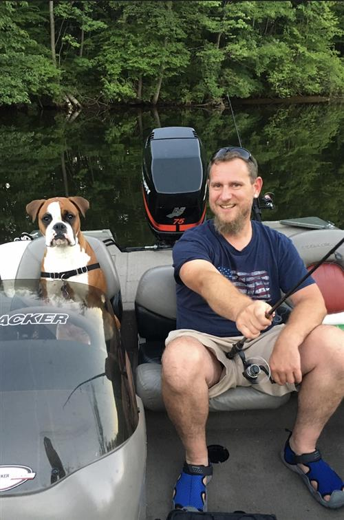 My dog Roxi and I on Lake George It was our first season with a boat.