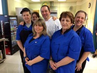 Chef Jeff is surrounded by his jr.-sr. high school staff.
