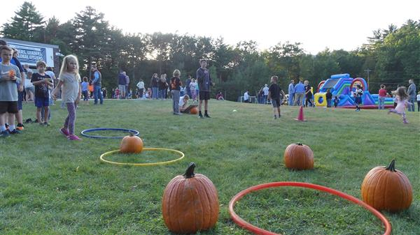 children playing games at the annual fall festival