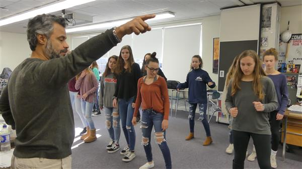 Johnny Martinez teaches students to dance the salsa