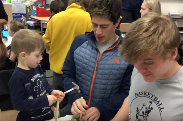 High School Seniors make crafts with kindergarteners