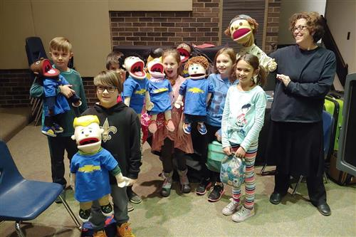 LGES students with large puppets