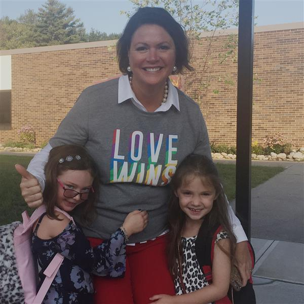 Superintendent Rutnik with two first grade girls