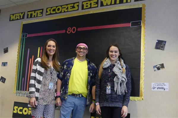 three teachers wearing mismatched clothing