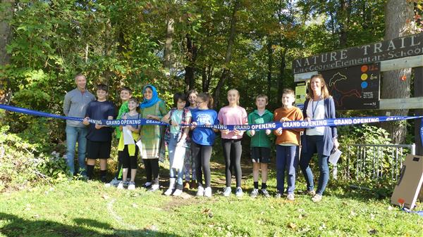 ribbon cutting ceremony for the LGES StoryWalk