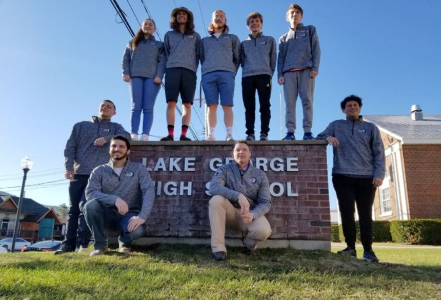Vex Robotics team picture in front of Lake George Jr.-Sr. High School