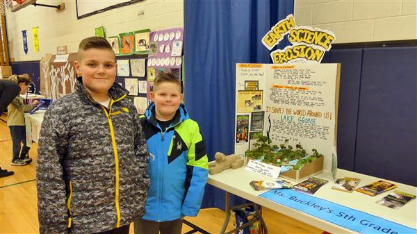 two brothers in front of erosion display